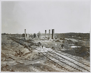 Aftermath of September 2, 1864, Confederate destruction of ammunition-laden railcars, near present-day Fulton Cotton Mill lofts, Atlanta, Georgia. Gelatin silver print by George Barnard. Courtesy of Library of Congress.