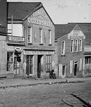 Auction and negro sales, Whitehall Street (present-day Peachtree Street), Atlanta, Georgia, ca. 1864. Wet plate negative by George Barnard. Courtesy of Library of Congress.