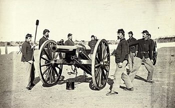 A twenty-pound Parrott Gun and its crew at Fort Richardson, Arlington Heights, Virginia, 1861–1865. The De Gress Battery was comprised of four rifled cannon of this type. Albumen print, ca. 1865.