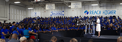 Michelle Obama speaks to students at Booker T. Washington High School, Atlanta, Georgia, August 8, 2014. Photograph courtesy of the US Department of Education, CC BY. School districts in historically black areas of the Atlanta metro region remain highly segregated.