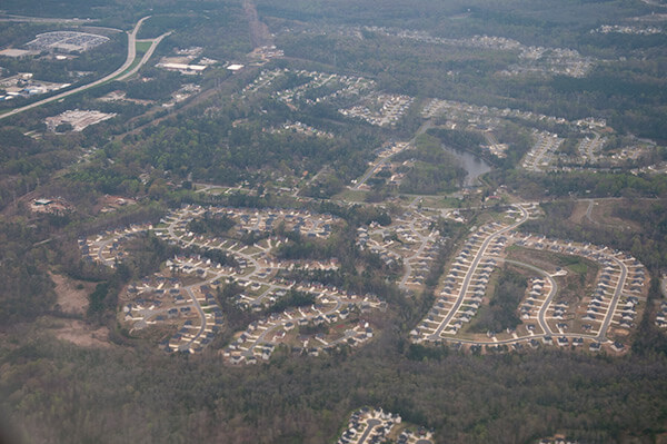 "Aerial view of suburban Atlanta, Georgia, March 31, 2009. Photograph by Maik. Courtesy of Maik, Creative Commons License CC BY-ND 4.0. Karen Pooley's ""Segregation's New Geography: The Atlanta Metro Region, Race, and the Declining Prospects for Upward Mobility,"" April 15, 2015."