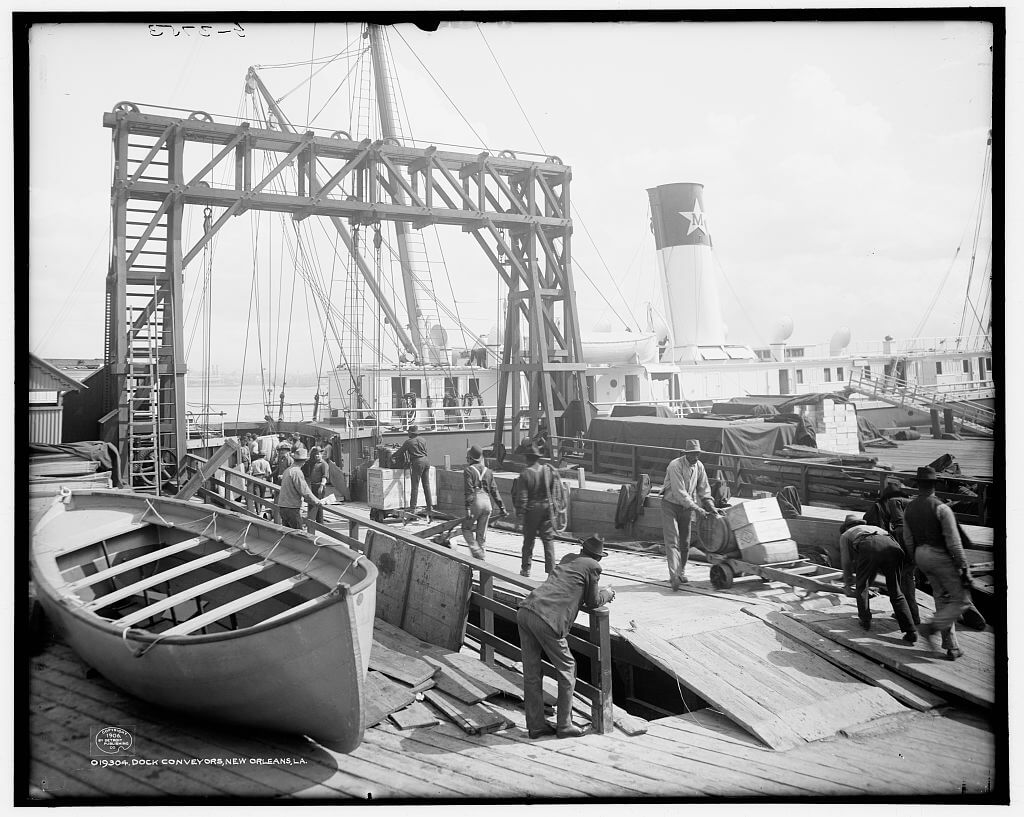 Black and white photograph of men working on a dock.
