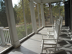 The porch at Andalusia, Flannery O'Connor's home in Milledgeville, Georgia. Photograph by pdoyen, November 12, 2008. Courtesy of pdoyen.
