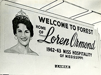 """Welcome to Forest"" sign, Forest, Mississippi, 1963. Photograph by Hugh Shankle. Mississippi Department of Archives and History, Hugh Shankle Collection, PI/COL/1981.0066. Courtesy of the Mississippi Department of Archives and History."