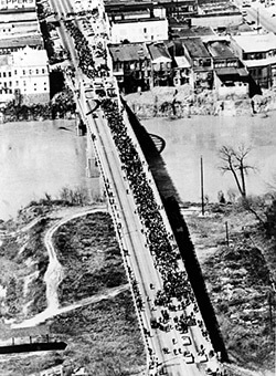 Ariel view of marchers crossing the Edmund Pettus bridge during the march from Selma to Montgomery, Alabama, 1965. Library of Congress Prints and Photographs Division, New York World-Telegram and the Sun Newspaper Photograph Collection, LC-USZ62-126846.