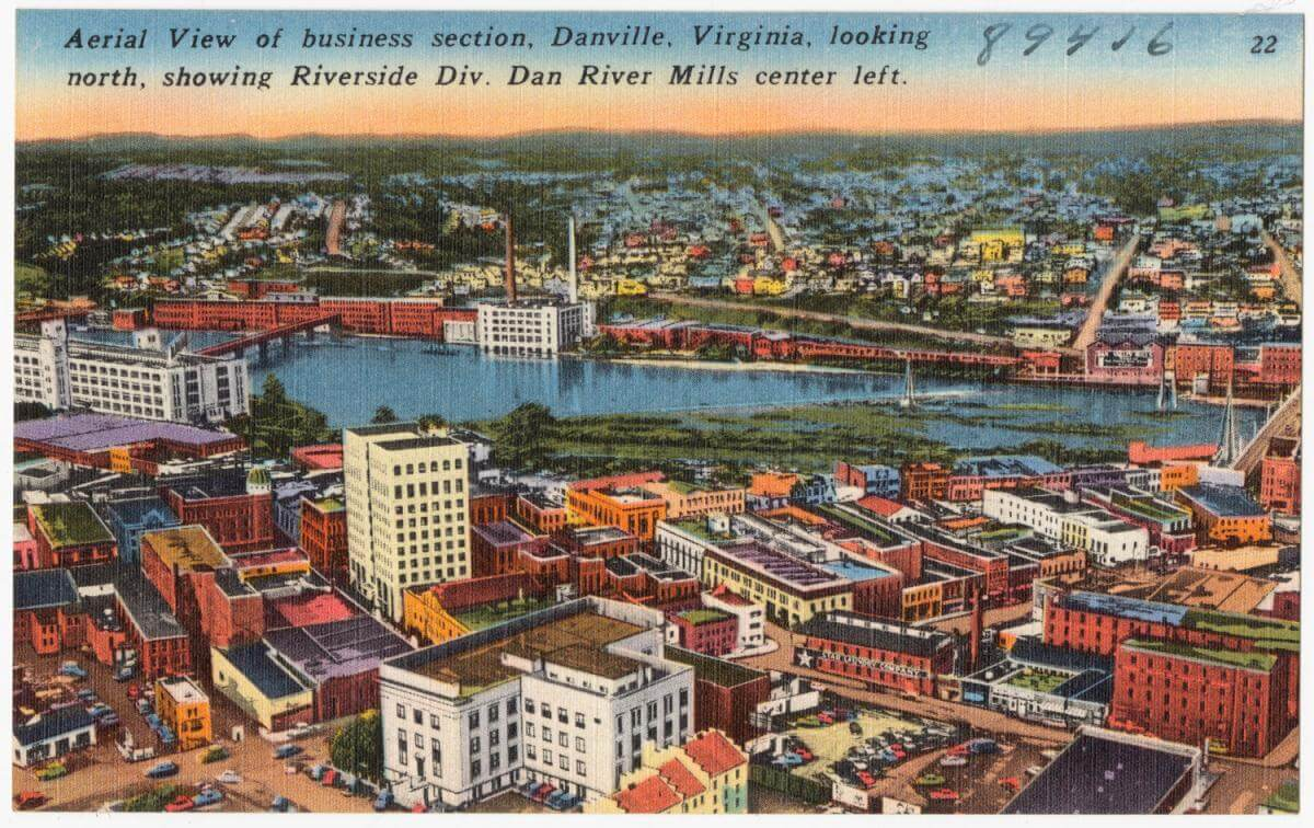 Aerial view of Business Section, Danville, Virginia, looking north, showing Riverside Div. Dan River Mills center left, 1930–1945. Courtesy of The Tichnor Brothers Collection, Boston Public Library. Creative Commons license CC BY 2.0.