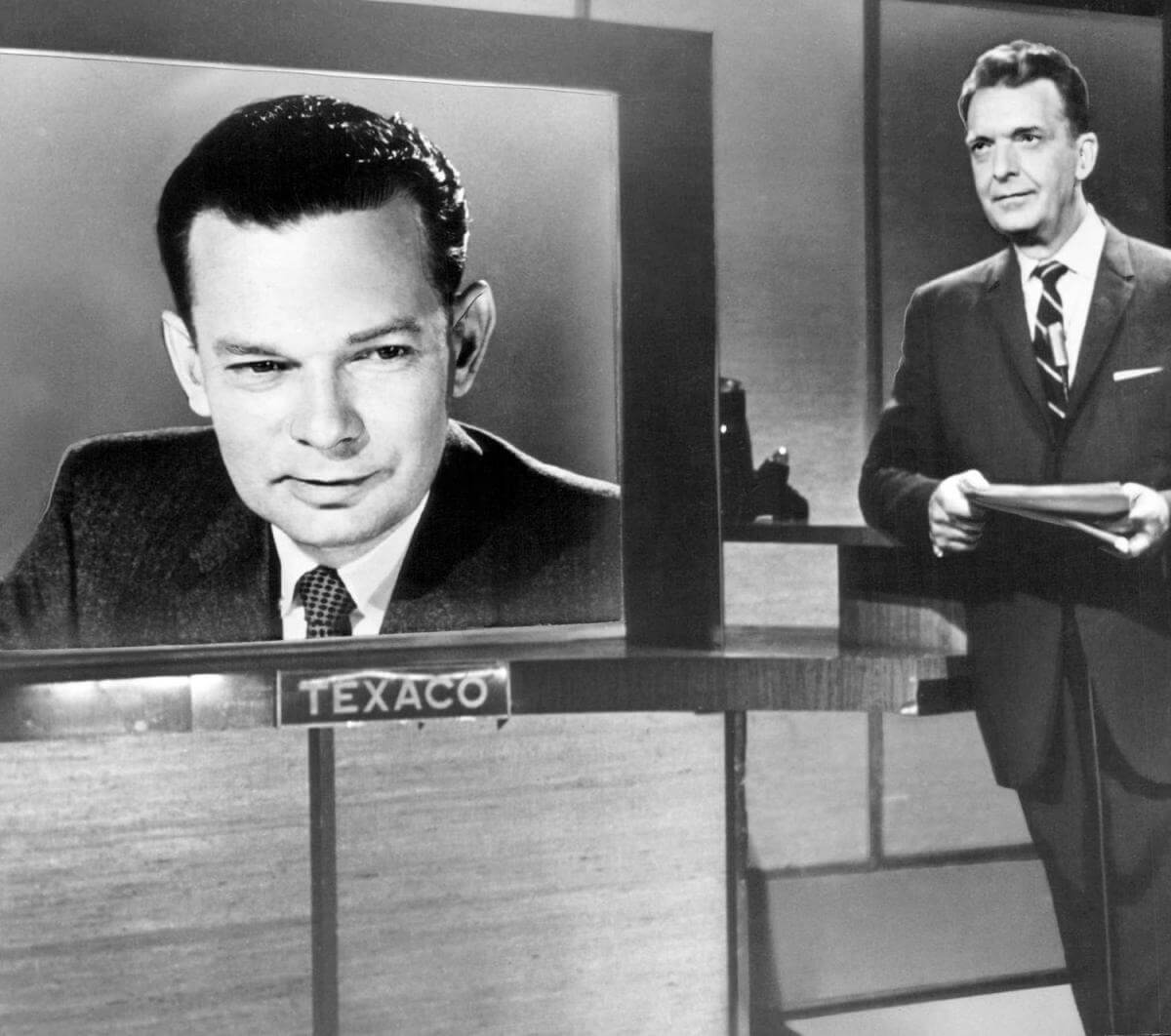 Photo of David Brinkley (on screen) and Chet Huntley from the news program The Huntley-Brinkley Report. Huntley was based in New York, while Brinkley was based in Washington. They shared the duties of the NBC Television Network evening news program from 1956 to 1970. Courtesy of Wikimedia Commons. Image is in the public domain.