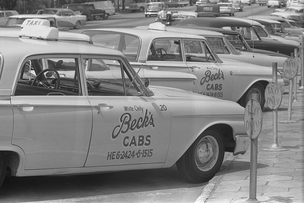 "Taxi cabs with sign ""White only, Beck's cabs"" on side, Albany, Georgia, August 18, 1962. Photograph by Warren K. Leffler. Courtesy of the Library of Congress, Prints and Photographs Division, http://www.loc.gov/pictures/item/2012649184/."
