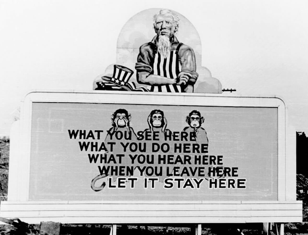 Billboard encouraging secrecy amongst Oak Ridge workers, Oak Ridge, TN, ca. 1940s. Photo by Ed Westcott. Courtesy of Wikimedia Commons. Image is in public domain.