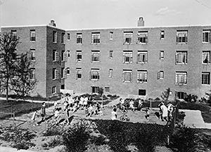 View of playground behind Building X, from west facing east, Techwood Homes. Atlanta, Georgia, circa 1940. Photocopy of Photograph. Library of Congress Prints and Photographs Division, HABS GA,61-ATLA,60--16.