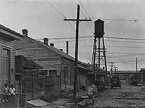 St. Thomas Street: the before photo. View shows street view prior to the demolition that cleared the area for the St. Thomas Housing Project. New Orleans, Louisiana, circa 1939. Photograph by US Housing Authority. National Archives and Records Administration, 196086.