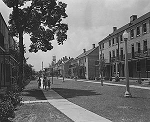 St. Thomas Street: the after photo. View shows completed St. Thomas Housing Project, circa 1940–1941. Photograph by US Housing Authority. National Archives and Records Administration, 196087.