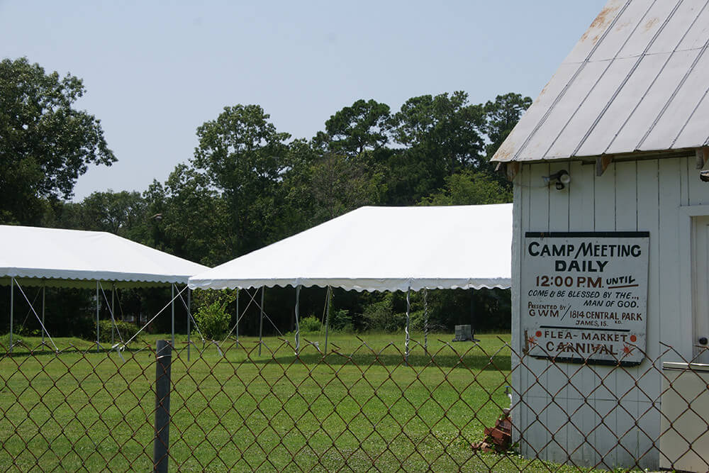 Camp Meeting buildings and tents, James Island, South Carolina, July 4, 2014. Photograph by Flickr user romana klee. Creative Commons license CC BY-SA 2.0.