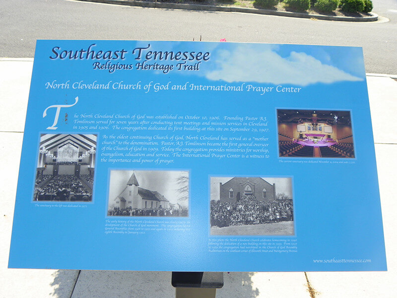"Photograph of a sign that reads, ""Southeast Tennessee Religious Heritage Trail,"" showing four photographs of different church interiors."
