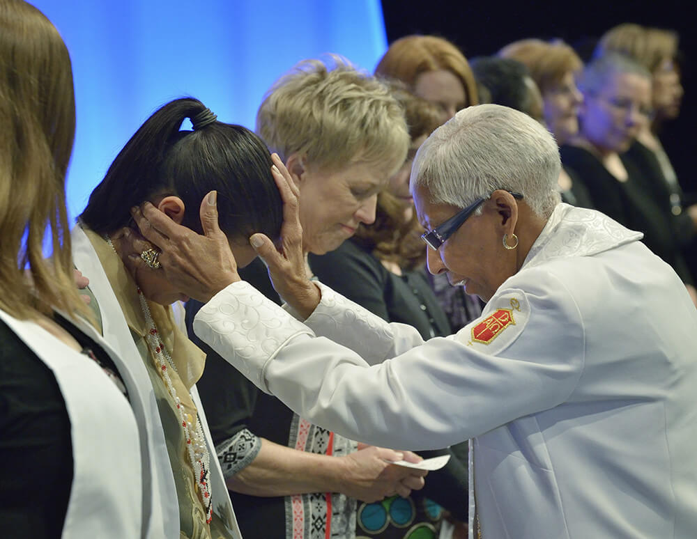 Deaconess consecrated at United Methodist Women's Assembly, Louisville, Kentucky, April 27, 2014. Photograph by Paul Jeffrey. Courtesy of Flickr user UMWomen. Creative Commons license CC BY-NC-ND 2.0.