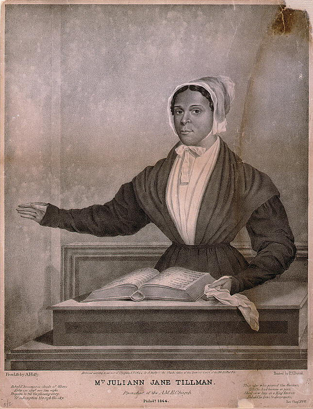 Lithograph depicting Mrs. Juliann Jane Tillman, A.M.E. Preacher, in front of the Bible with her arm outstretched, as though preaching.