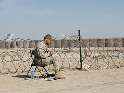 Michael D. Fay at work at a big airbase called TQ (Al-Taqaddum), Iraq, March 2006. Photograph courtesy of the artist.