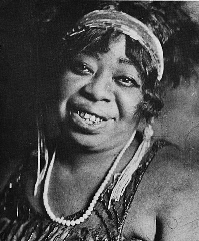 "Gertrude Pridget ""Ma"" Rainey smiling at the camera."