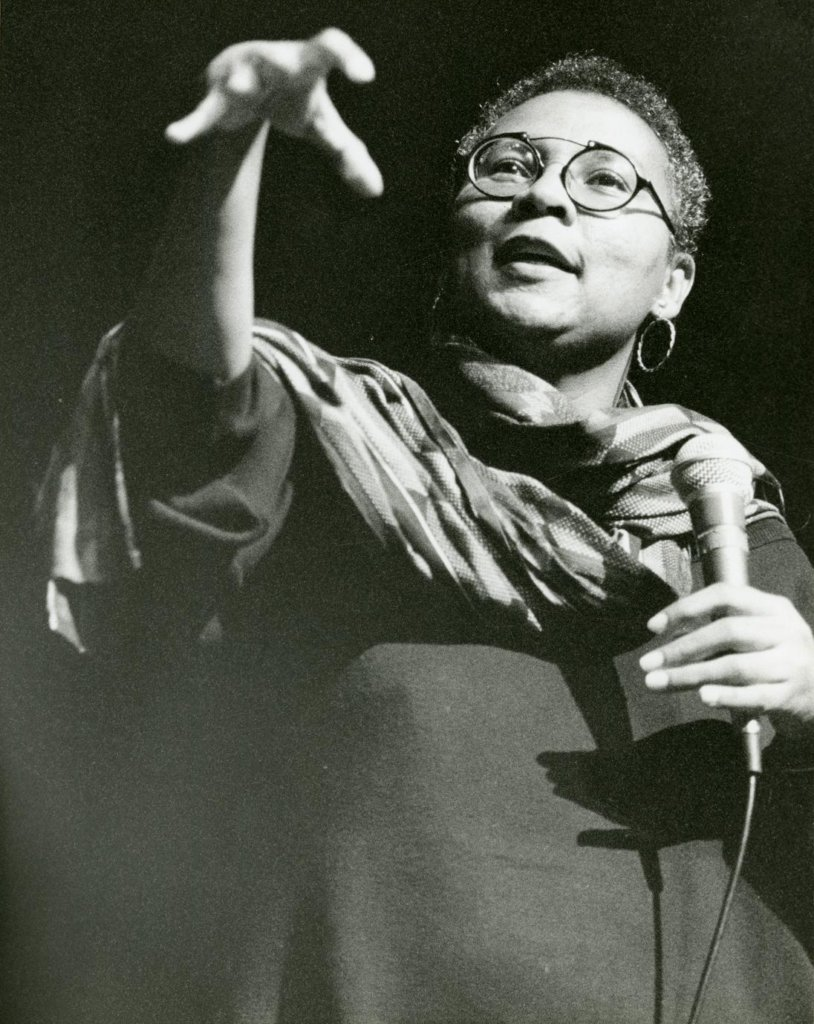 bell hooks speaking into a microphone.